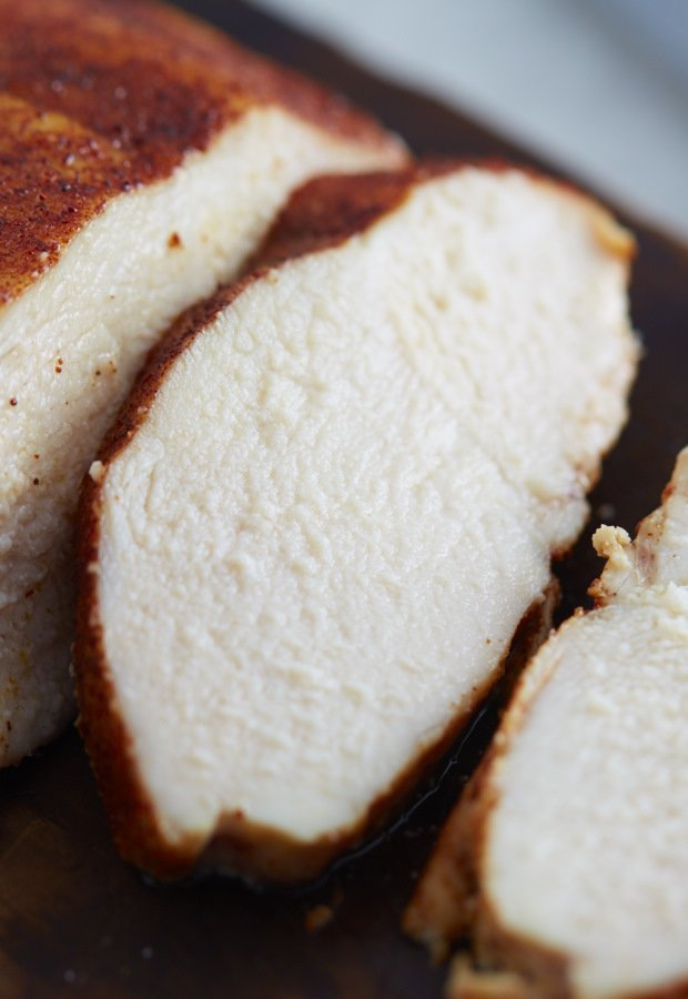 Slices of slow roasted chicken breast, moist and juicy.