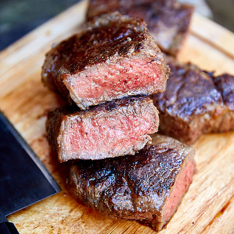Learn how to make a perfect steak on the stove with this easy to follow guide.The best way to cook a steak indoors is to start with pan searing and finish in the oven. The steak will be perfectly caramelized on the outside and tender inside. Then let it rest and finish quickly in the oven. This will give the a perfectly cooked, tender and juicy steak every time. The best steak ever. | ifoodblogger.com
