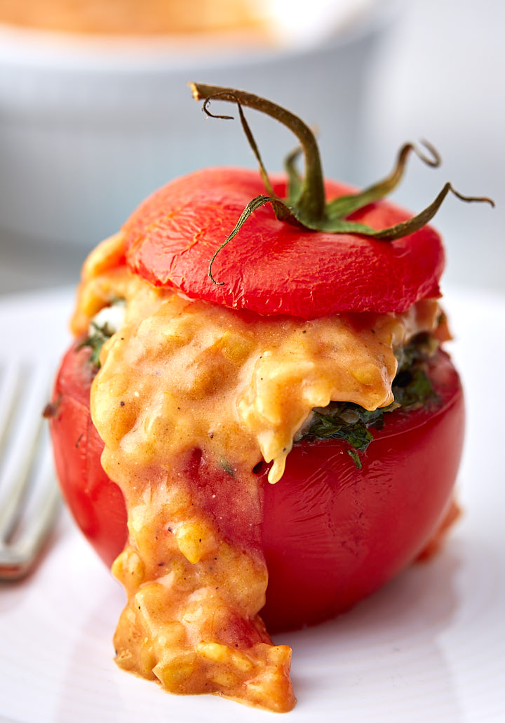 Stuffed tomato with sauce.
