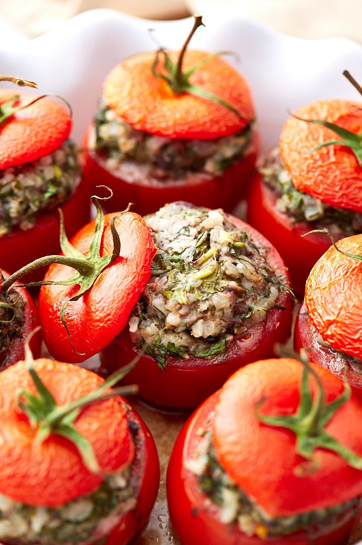 Stuffed tomatoes in a baking dish.
