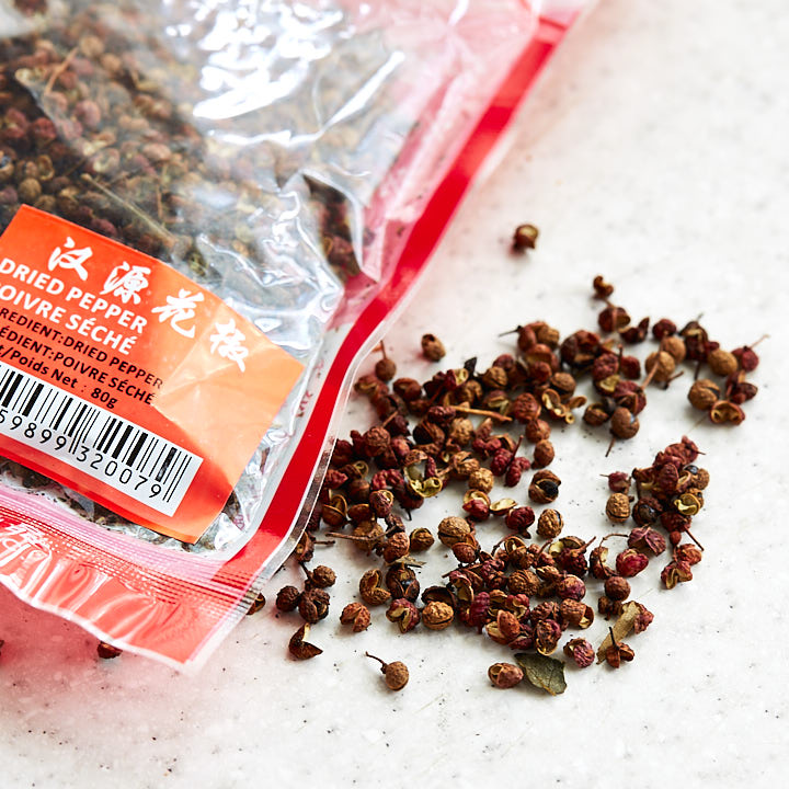 Szechuan peppercorns on a table.