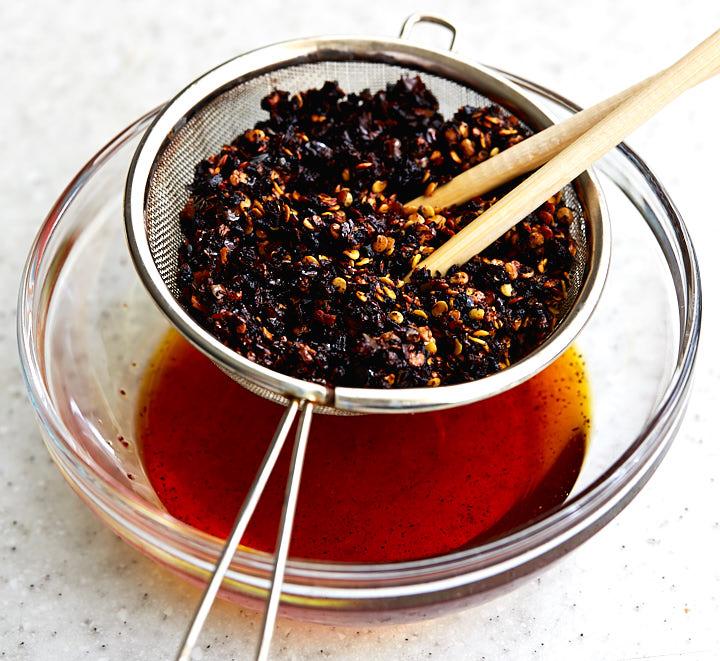 Making Szechuan pepper hot oil.