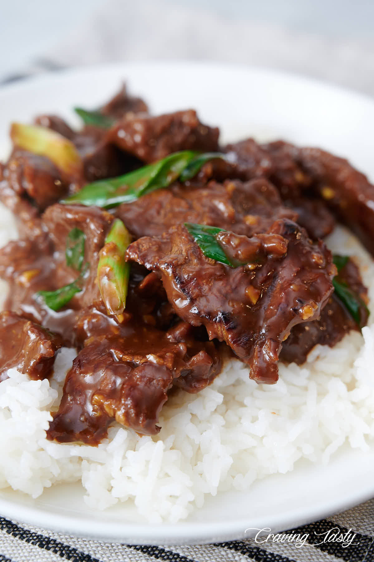 A bowl of Mongolian beef over white rice.
