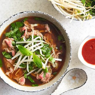 Authentic beef pho (pho bo) that will captivate you with its aroma and the taste that seamlessly combines salty, sweet, and umami all in one. The beef pho recipe comes from a restaurant that is famious for its pho bo. A must try. | ifoodblogger.com