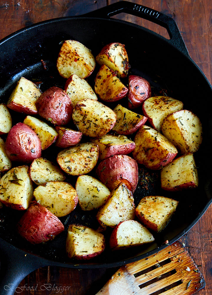Roasted potatoes in cast iron pan.