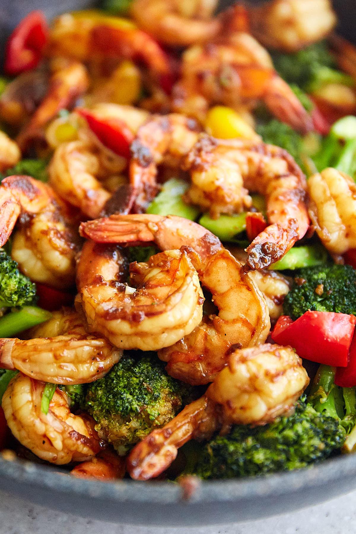 Szechuan shrimp with vegetables in a wok.