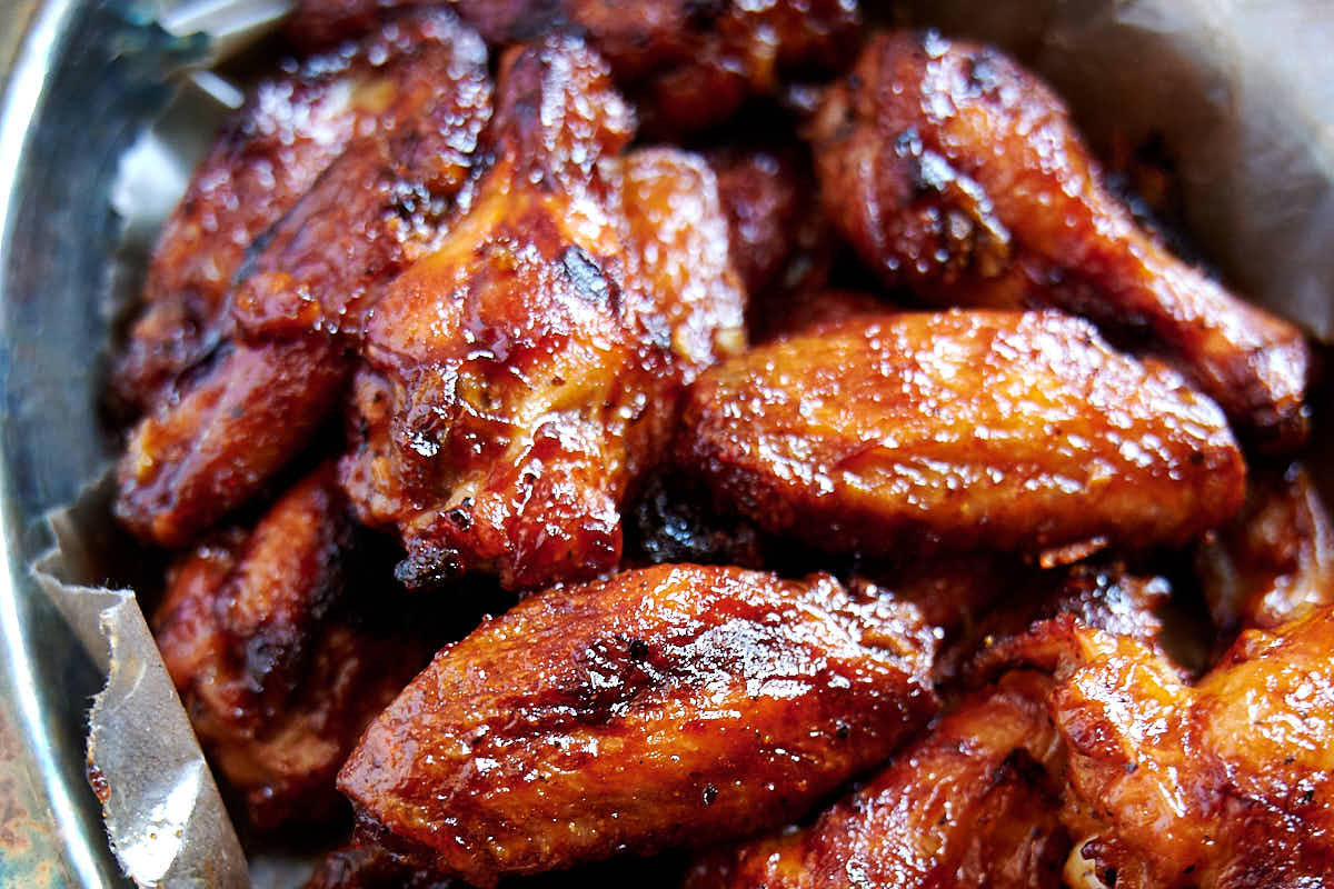 Best Baked BBQ Chicken Wings, period. First, the wings are baked on convection until super crispy, then coated in BBQ sauce and baked some more. The end result is sticky and addictive baked chicken wings that you can't have enough of. | ifoodblogger.com