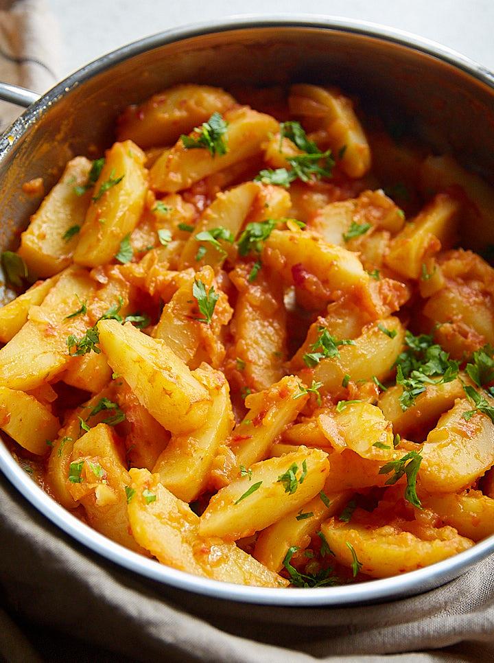 Sauteed Hungarian potatoes in a pan.