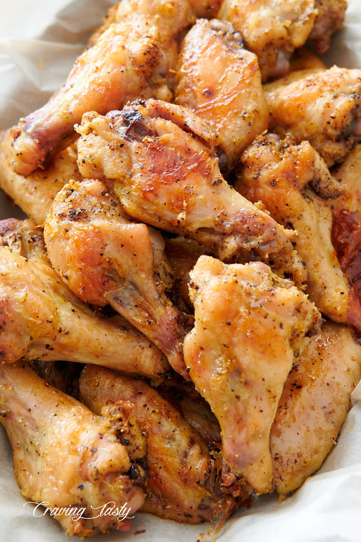 Close up of lemon pepper chicken wings in a basket, ready to serve.