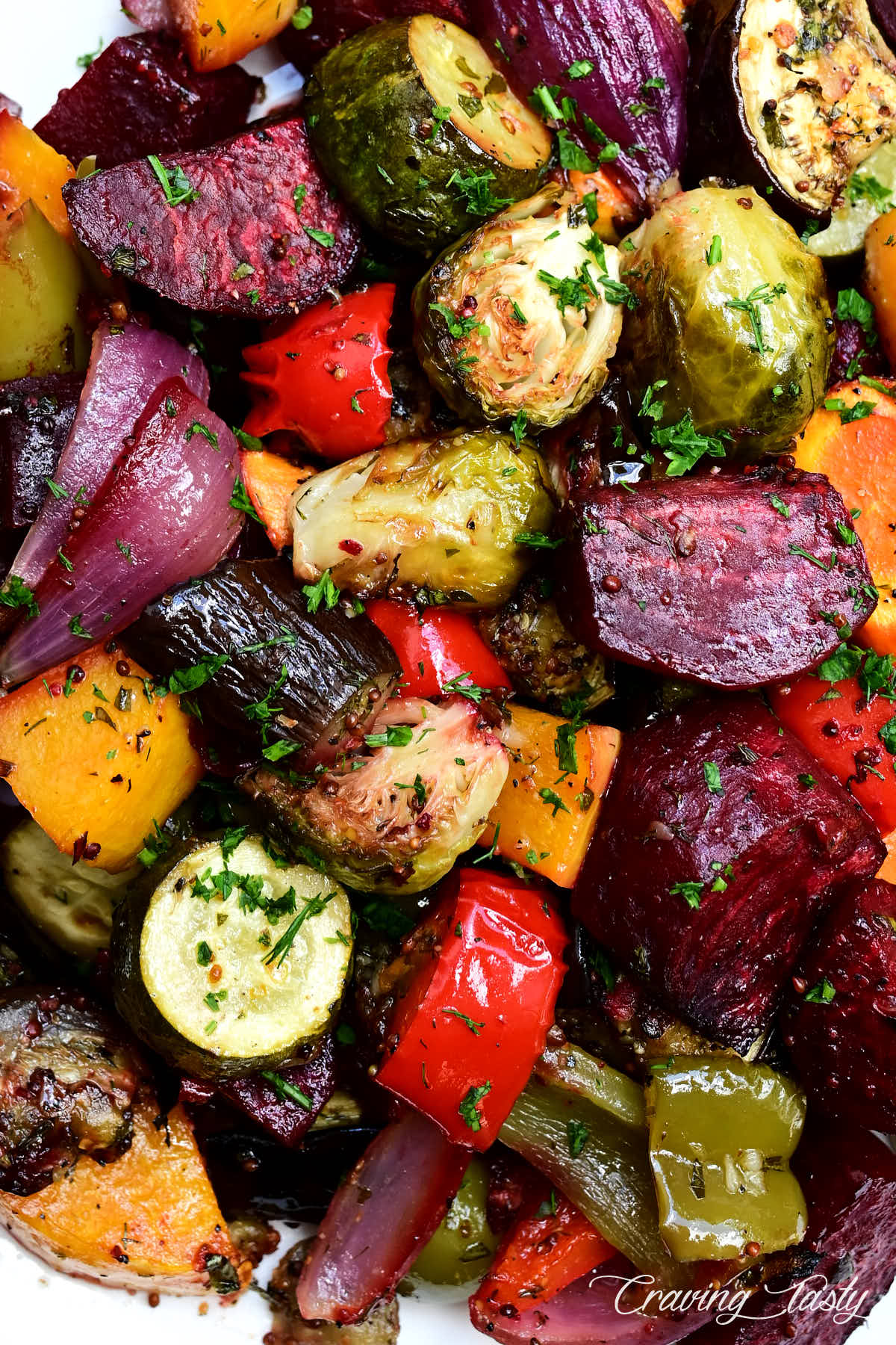 Perfectly cut, bite size roasted vegetables sprinkled with fresh herbs.
