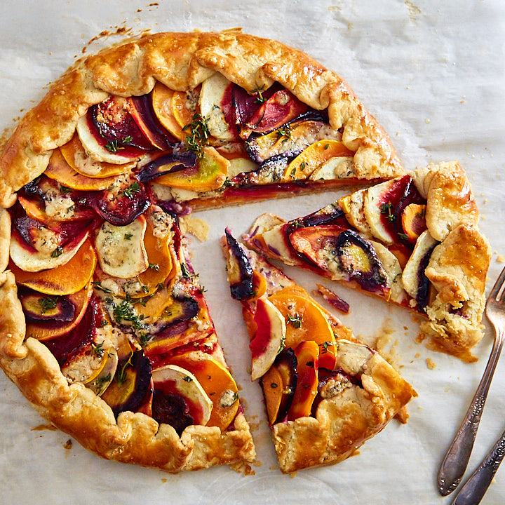 Vegetable galette cut into slices.