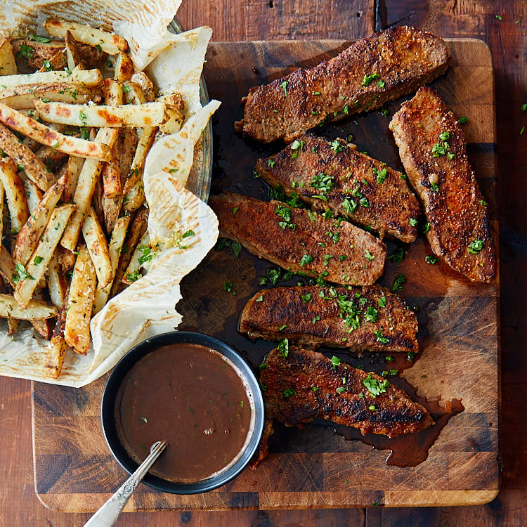 Tri-Tip Steak served with truffle fries and red wine sauce.