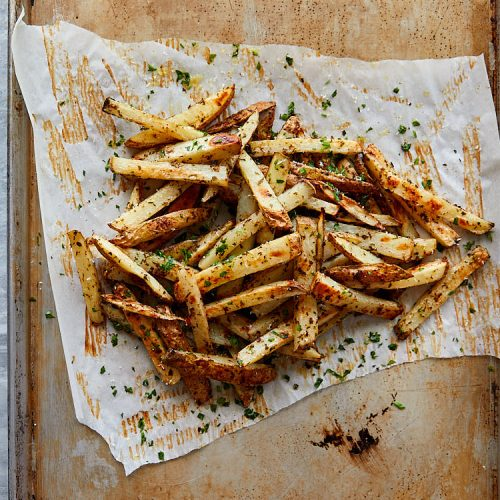 Truffle fries recipe instructions – tear off excess parchment paper