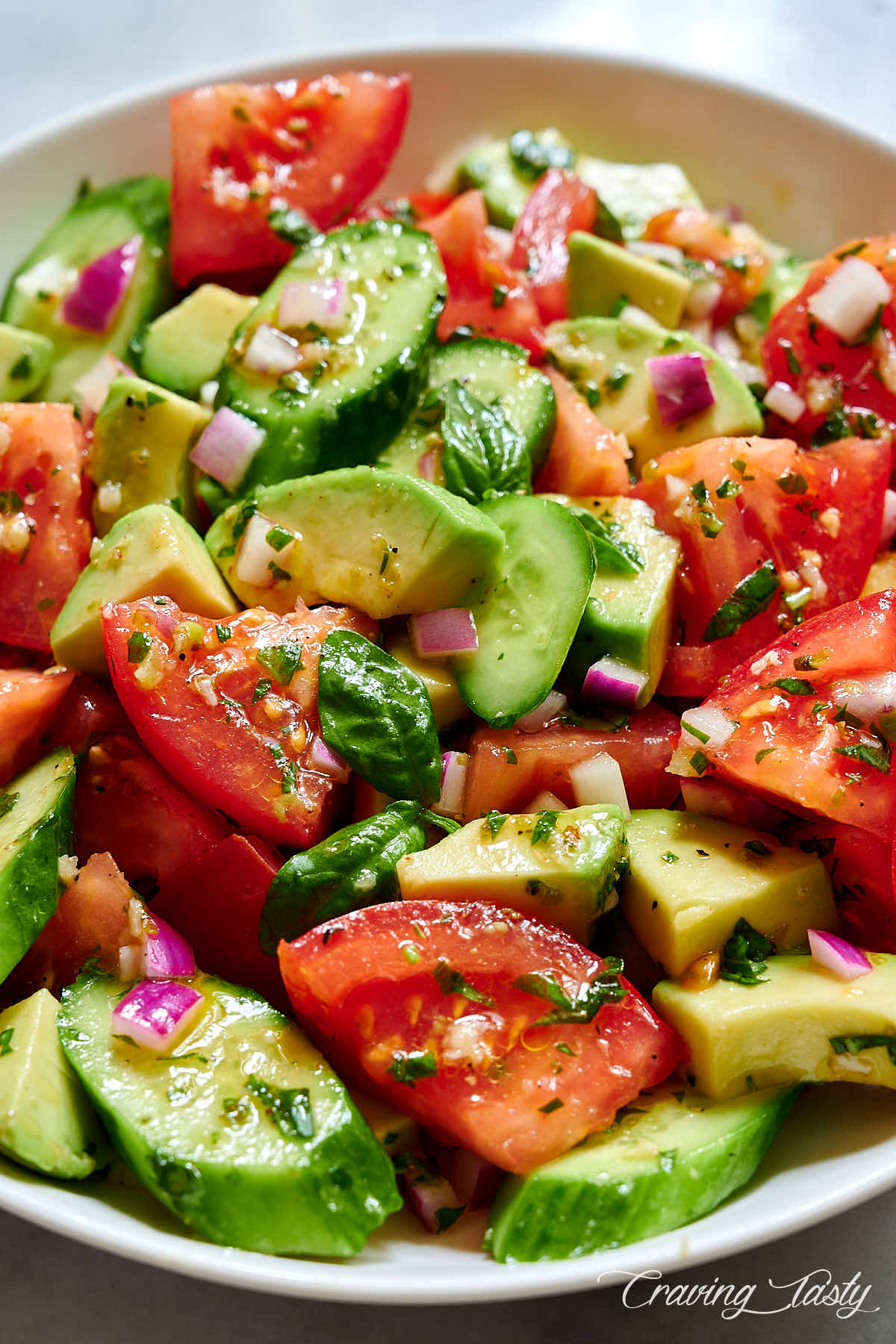 Close up view of tomato, cucumber and avocado salad.