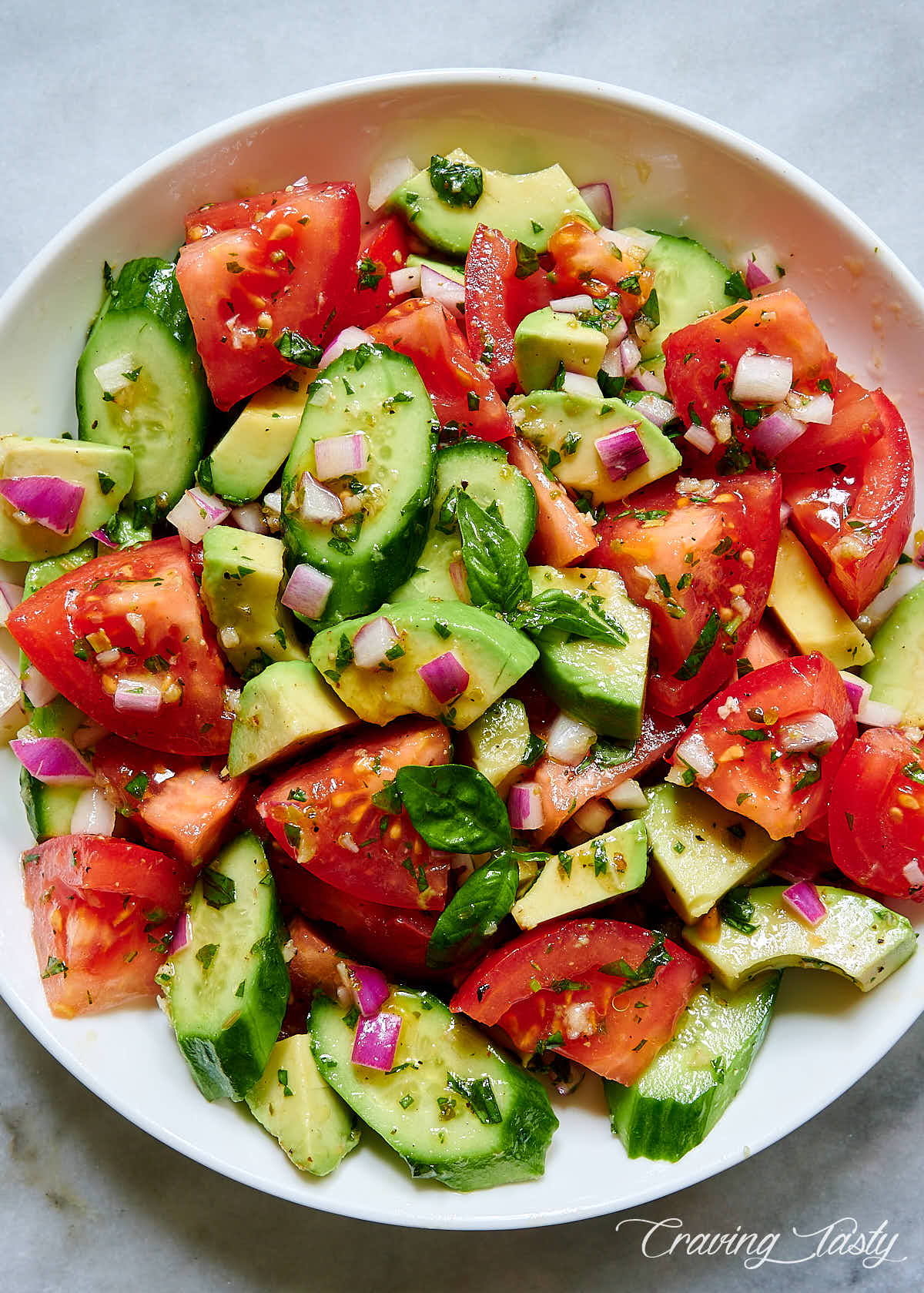 Tomato, Cucumber and Avocado Salad in a white bowl.
