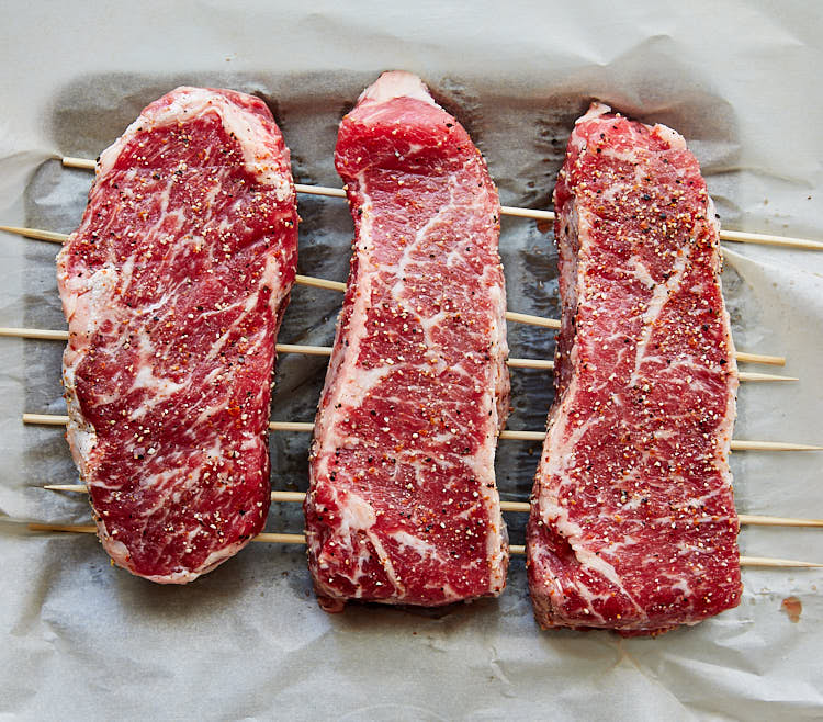 Salting steak in a fridge for a few hours before broiling makes them tender and more flavorful.