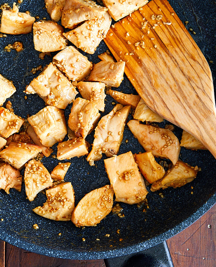 Hibachi chicken on a skillet with a spatula.