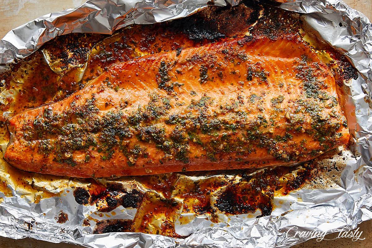 Baked steelhead trout on foil.