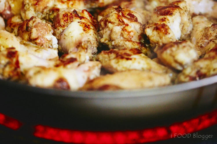 Chicken wings on a frying pan.