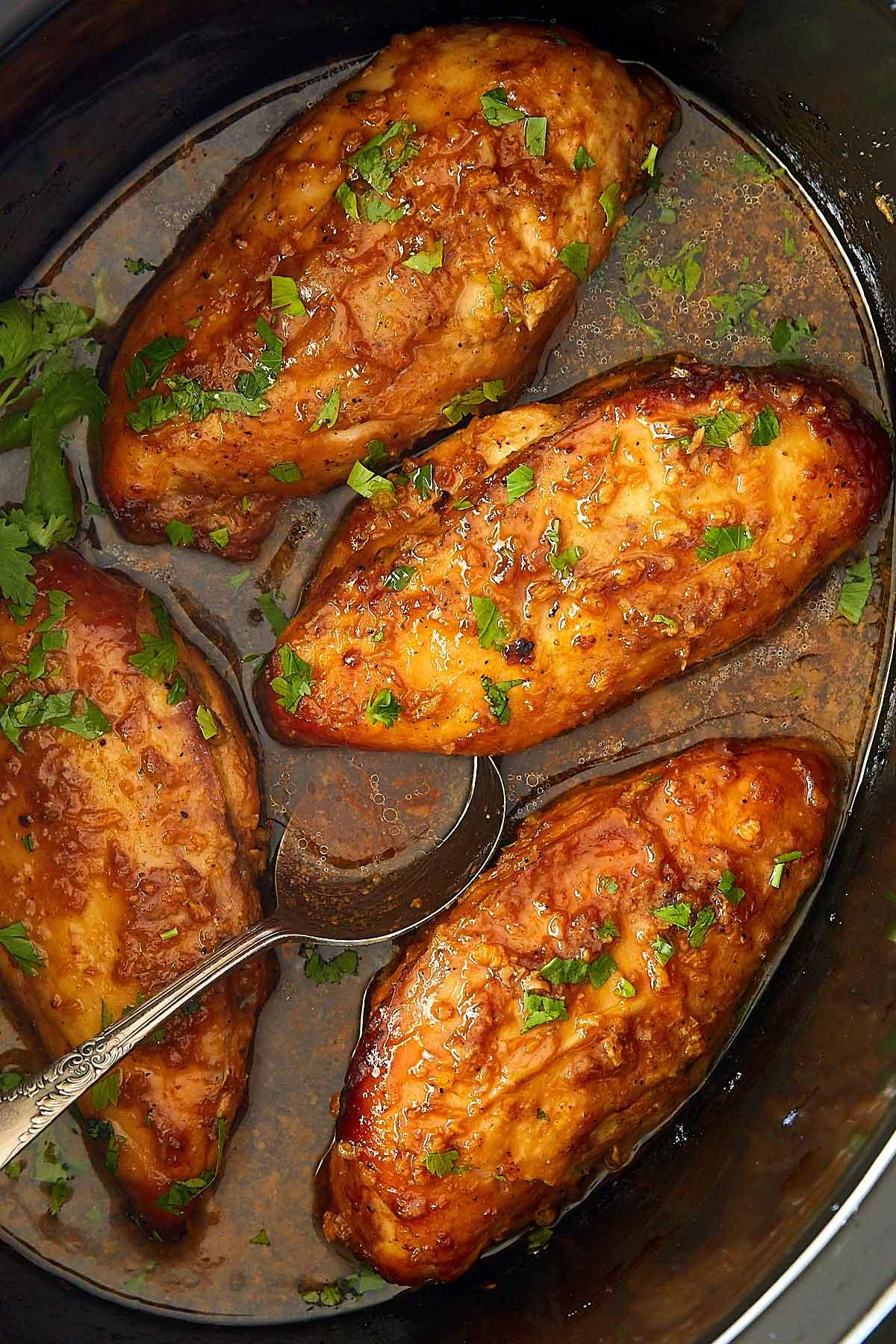 Slow Cooker Chicken Breasts inside slow cooker.