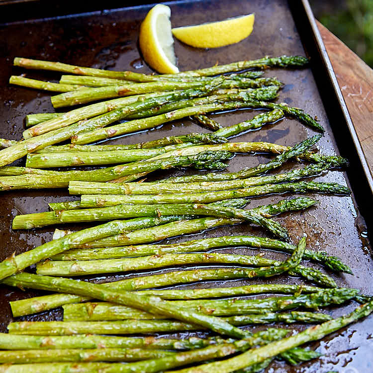 Boiled asparagus, tenderized with a quick parboil, seasoned with lemon juice, salt and pepper, and garnished with Parmigiano Reggiano cheese. | ifoodblogger.com