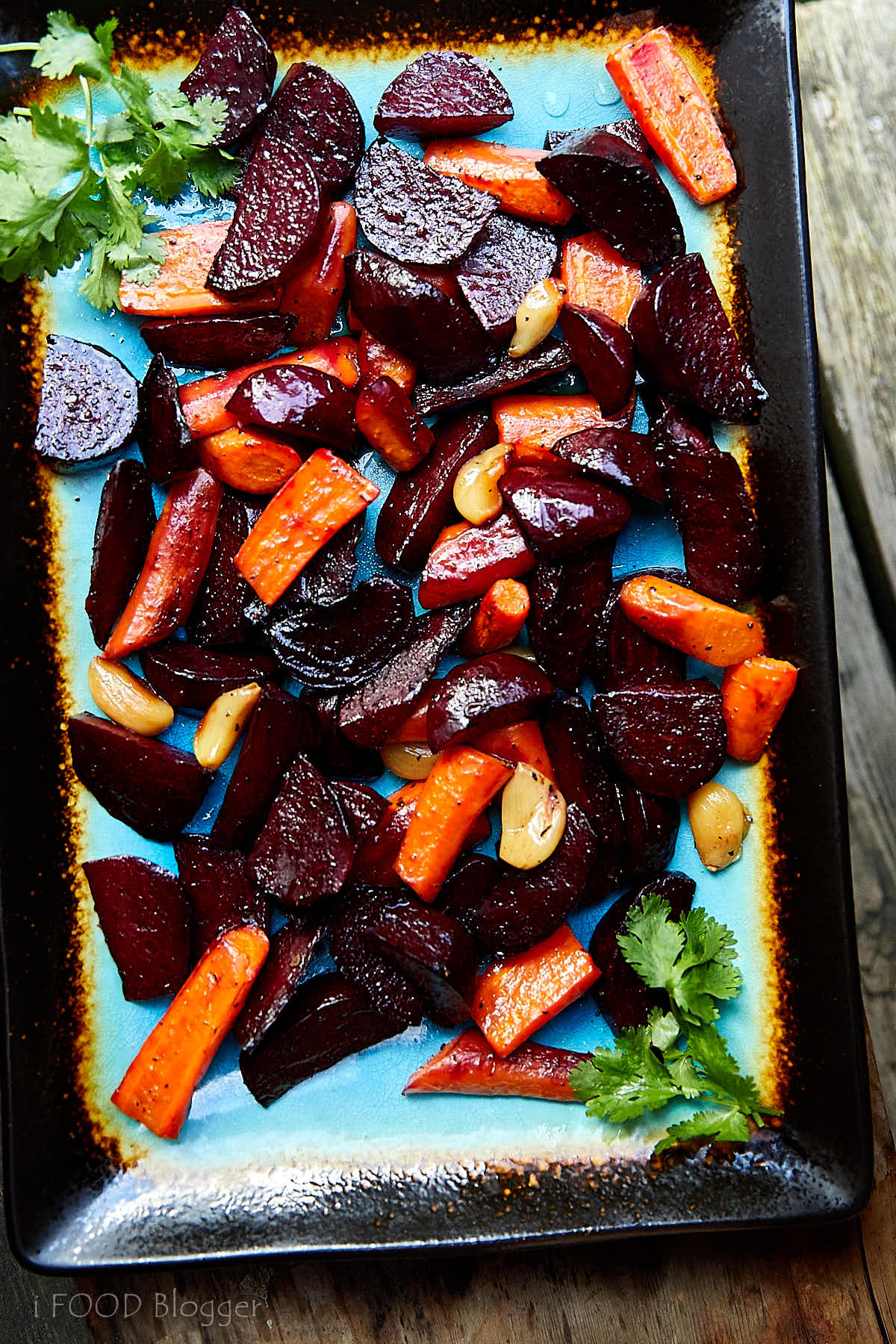 Roasted Beets and Carrots with Feta on a serving platter.