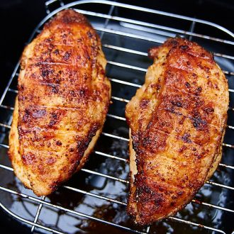This air fryer chicken breast is crispy on the outside and very juicy inside. It's ridiculously delicious! This chicken breast tastes just like fried, only without an oily mess and added calories. I guarantee you, this is one of the best chicken breasts you can make. They are a must try! Oh, and they only take 30 minutes to cook. A great chicken breast recipe for keto, paleo, weight watchers and low carb diets.| ifoodblogger.com