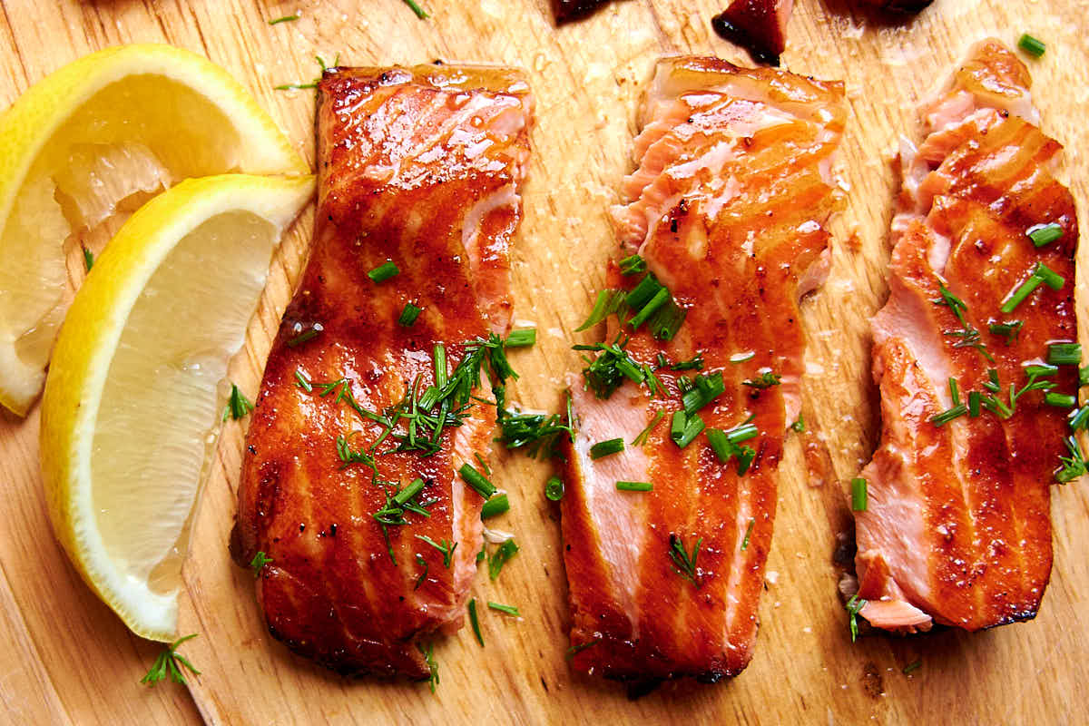 Salmon bellies glazed with delicious Asian inspired sauce and air fried to crispy perfection. This is one of the best salmon belly recipes and is a must try. | ifoodblogger.com