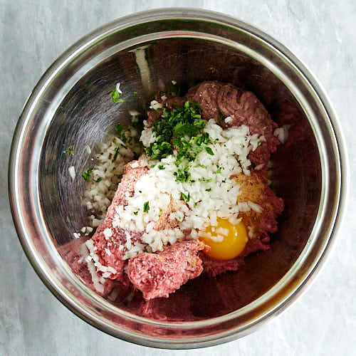 Asian meatball ingredients unmixed in a bowl.