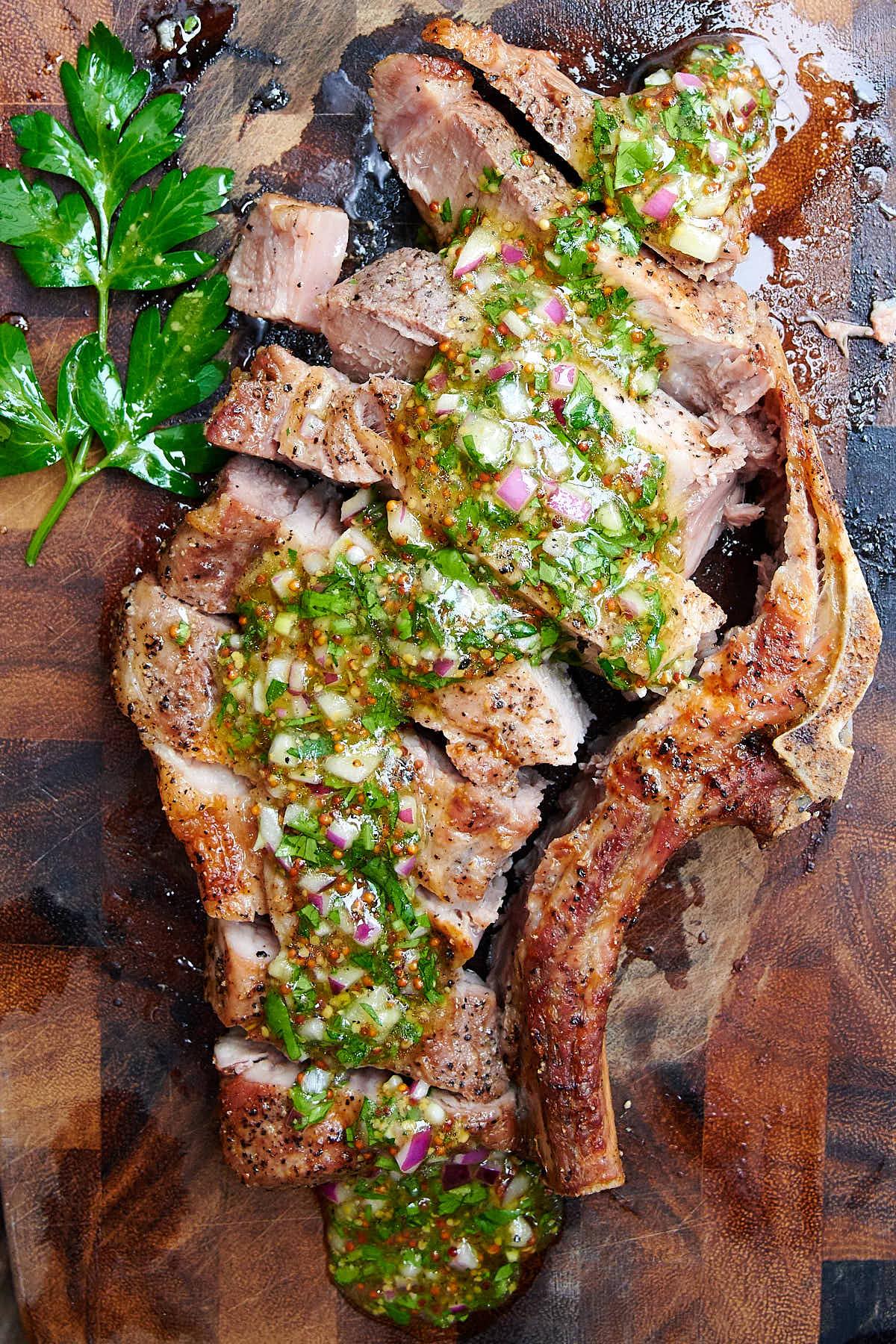 Sliced air fryer steak on a cutting board.