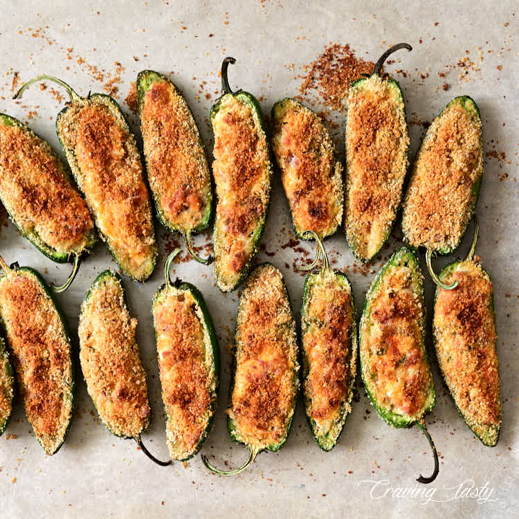 Well-browned under a broiled baked jalapeno poppers on a baking sheet.