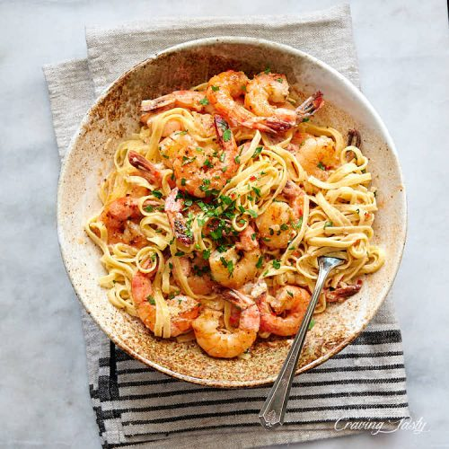 Creamy garlic butter shrimp with pasta in a bowl.