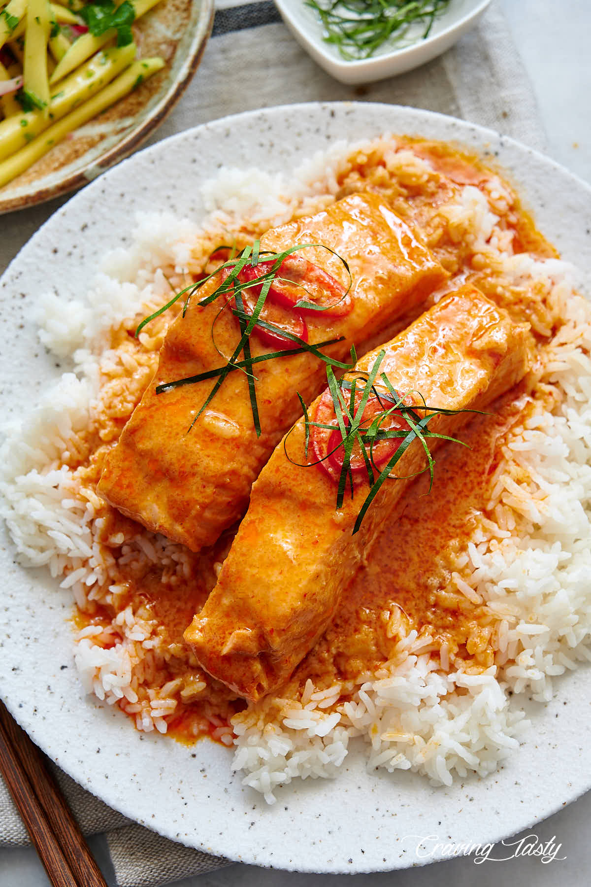 Salmon and curry over white rice.