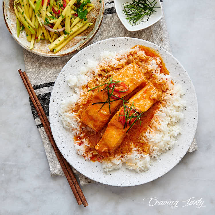 Salmon pan-seared in delicious Thai red curry sauce.