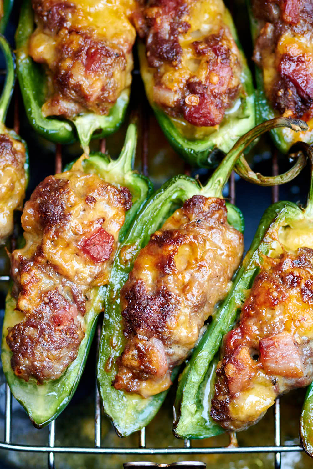 Juicy, moist jalapeno poppers on an air fryer rack.