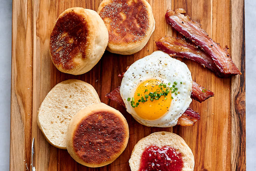 Oven-baked bacon with homemade English muffins.