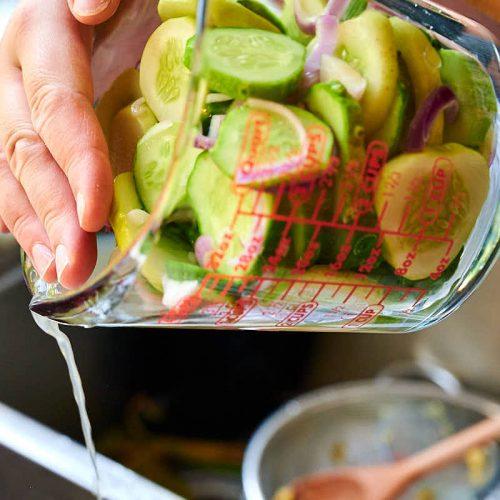Draining off cucumber juices.