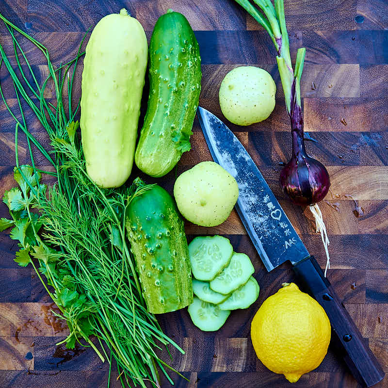 Heirloom cucumbers on a cutting board.